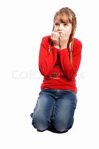 Scared girl hiding face | Stock Photo | Colourbox