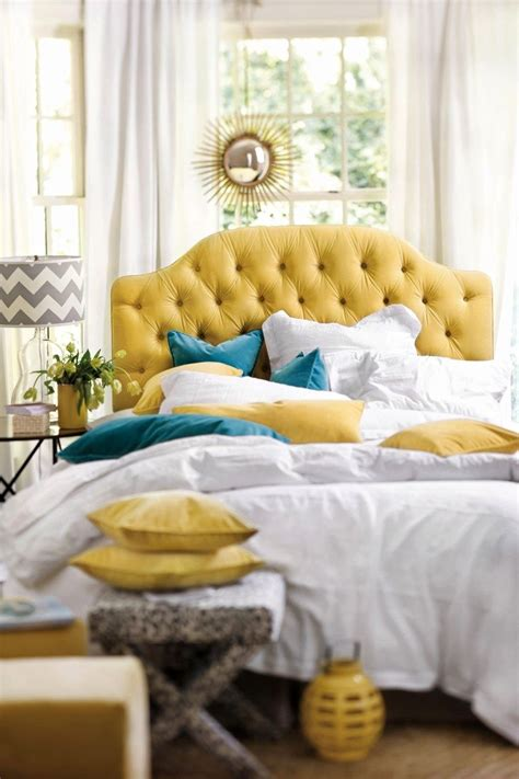 yellow and blue bedroom yellow tufted headboard with blue velvet pillows and white 17894 | cc62afed663d3657c0a65b0d1ff14d43