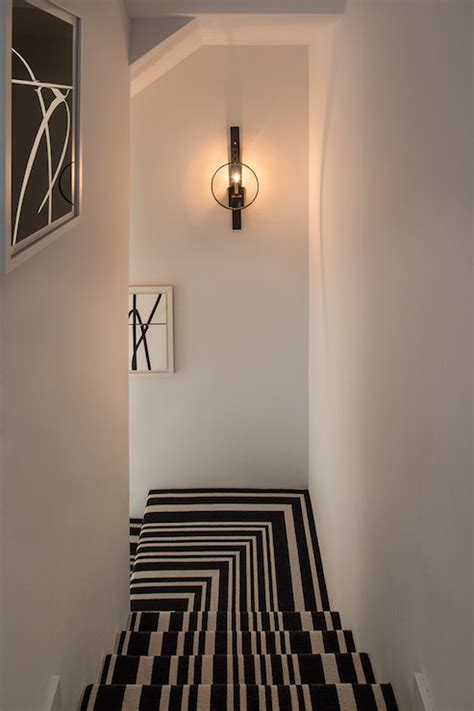 stairwell sconce black and white stripe stair runner contemporary