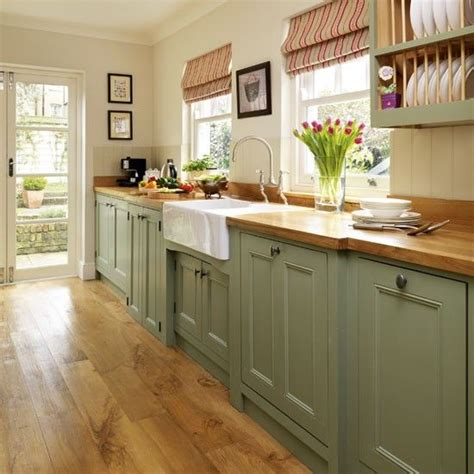 green paint colors for kitchens painted kitchen step inside this traditional soft green 6946