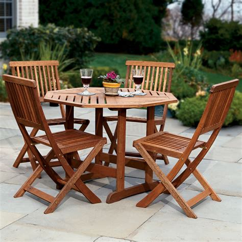 outdoor patio table and chairs the trestle patio table and stow away chairs hammacher