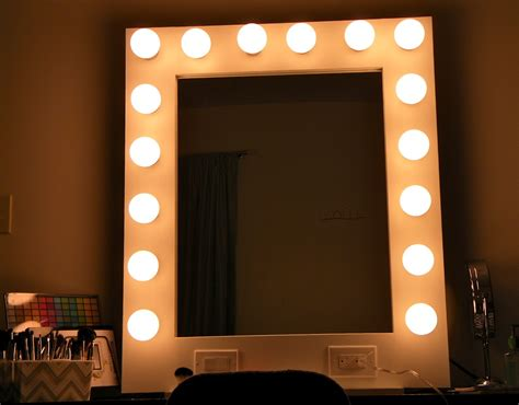 white framed vanity mirror with bulb lights of mirror with