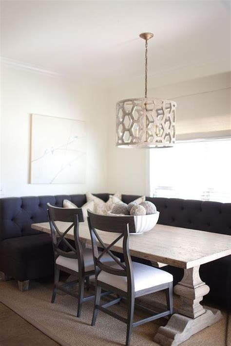 black tufted dining banquette  reclaimed wood dining