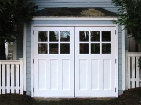 hand  custom carriage garage door  real swing