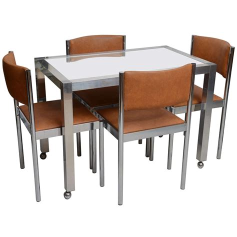 chrome table and chairs chrome and glass table with 4 chrome upholstered chairs