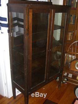 antique mahogany china cabinet  shelves   sides