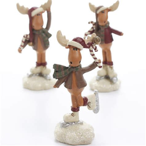 miniature ice skating moose figurines table decor