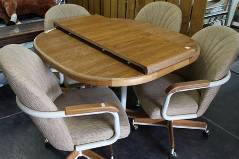 rolling dinette chairs dinette table w 1 leaf 4 rolling chairs 1983