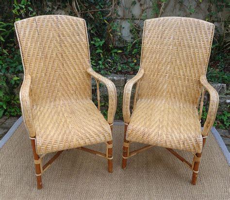 paire de fauteuils anciens en rotin