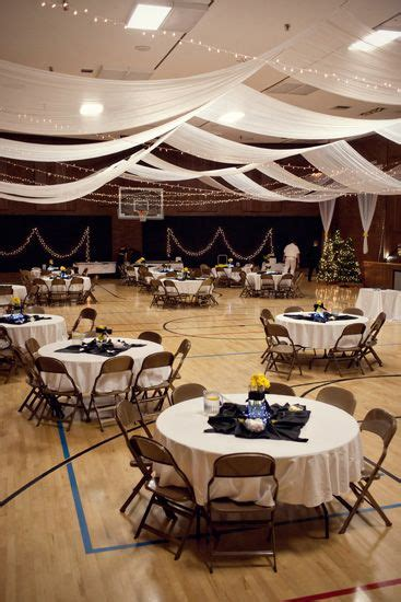 a church gym transformed into a wedding venue my only problem is the floor but that s fine if