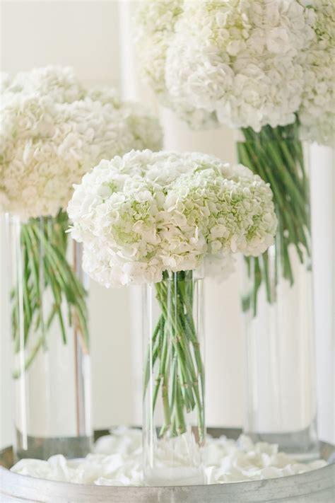 white wedding flowers white hydrangeas reception