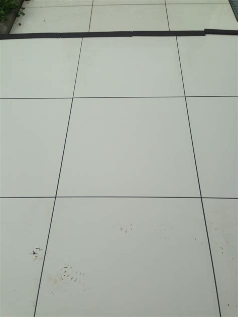shiny porcelain tile applying ant slip to a shiny porcelain patio east surrey tile doctor