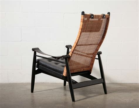 Free shipping on many items | browse your favorite brands | affordable prices. Muttendam Mid-Century Rattan and Leather Armed Lounge ...
