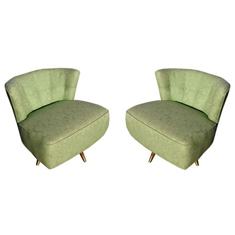 pair of 1950 s mid century swivel lounge slipper chairs