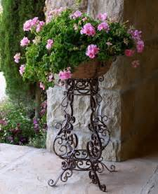 the wrought iron flower stand garden flowers