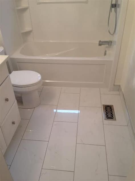 ceramic tile   floor white cabinet tub