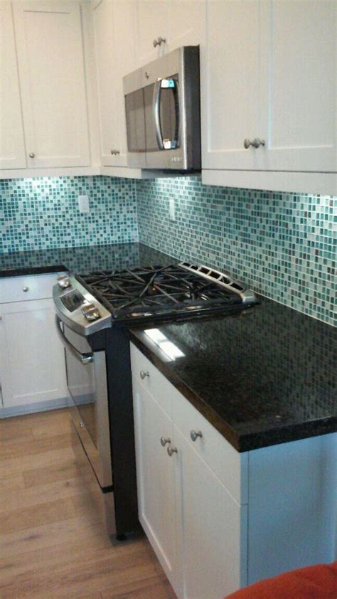 blue glass kitchen backsplash butterfly green granite countertops with a square edge and 4809