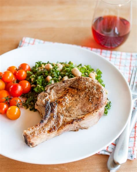 how to cook pork chops in oven how to cook tender juicy pork chops every time the kitchn