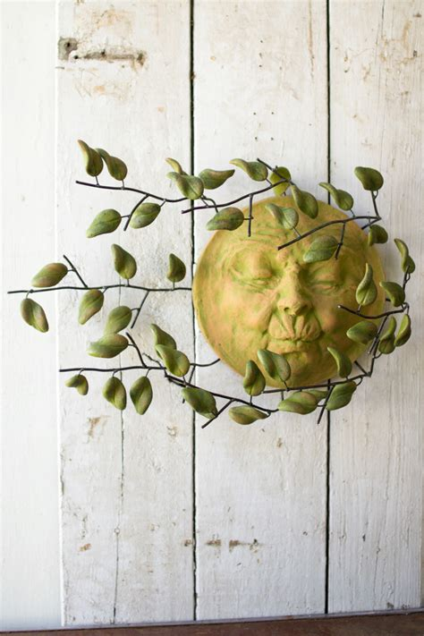 wind blown sun face  clay leaves wall hanging