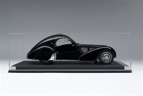 Bugatti's most expensive car ever is built to pay homage to the beautiful and artistically designed type 57sc atlantic. BUGATTI 57SC ATLANTIC (1936) 'LA VOITURE NOIRE' 1:8 - Eksklusive Modelbiler