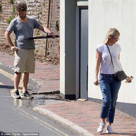 Zoe Ball goes make up free as she steps out alongside beau ...