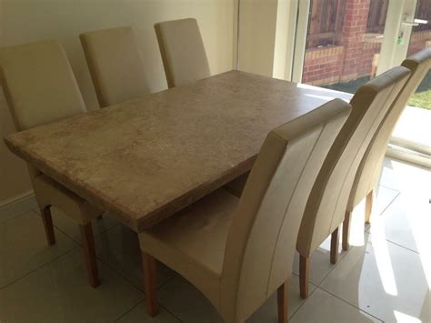 barker  stonehouse marble stone dining table   leather chairs  ingleby barwick