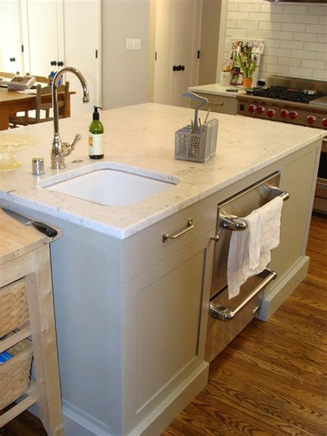 kitchen island with sink and dishwasher and extra sink and dishwasher drawers in the island great