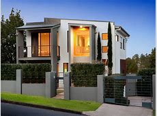 Concrete modern house exterior with balcony & hedging