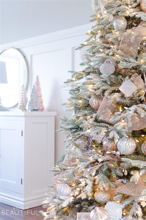 snowy flocked christmas tree christmas tree decorating