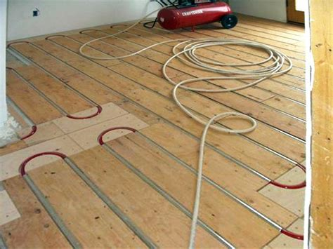 pex radiant floor heating panels thermofin u and pex tubing installed with plywood sleepers