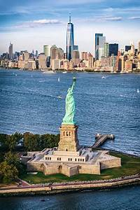 Aerial, View, Of, The, Statue, Of, Liberty, In, Front, Of, Manhattan