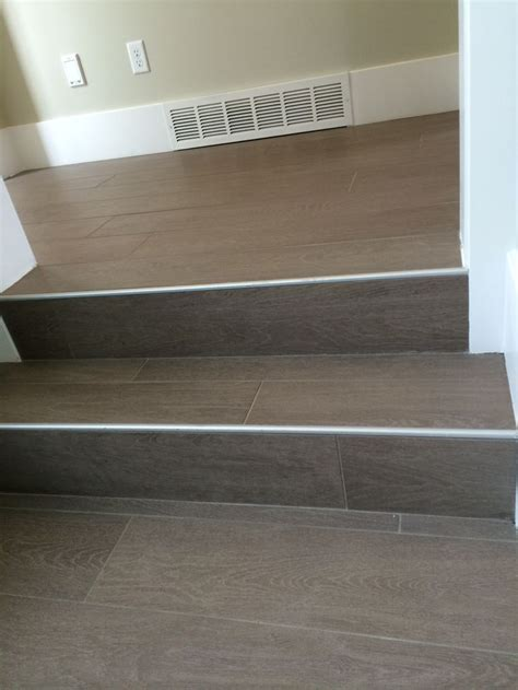 tile flooring on stairs wood floor tile on stairs with metal end cap painted stairs pinterest cap d agde metals