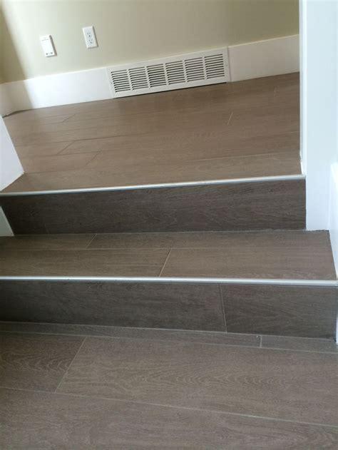 Wood floor tile on stairs with metal end cap   Painted