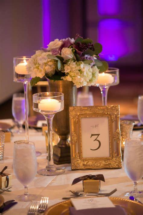gold framed table number  floating candles