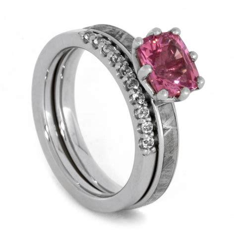 bridal with pink gemstone meteorite engagement ring and swarovski wedding band in