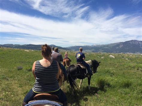riding horseback near yellowstone land horse trail ranch hard fat happy ride mybigfathappylife national park wind were told guides history