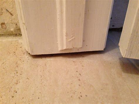 caulking   fill  door frame  tile home