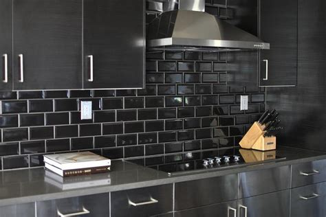 Stainless Steel Kitchen Cabinets With Black Subway Tile
