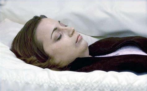Beautiful women in their caskets. Woman in her open casket during her funeral.   Post mortem ...