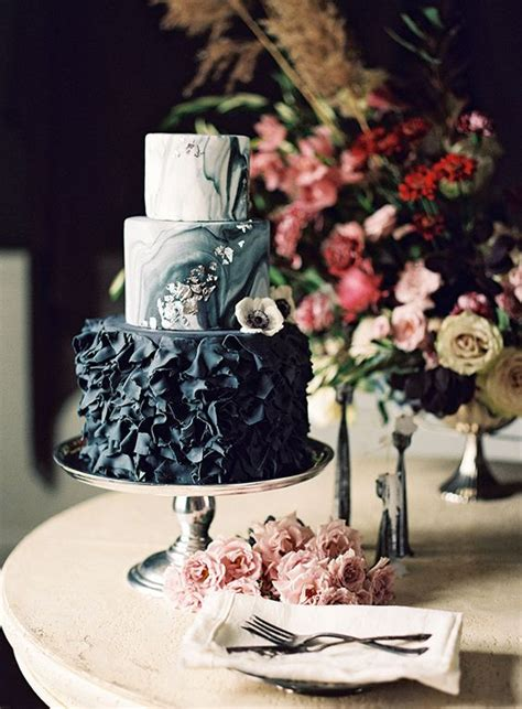 picture of black wedding cake with painted and flowers