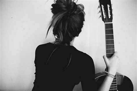 Black And White Girl Guitar High Bun Messy Image