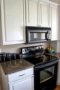 white painted kitchen cabinet reveal 1496