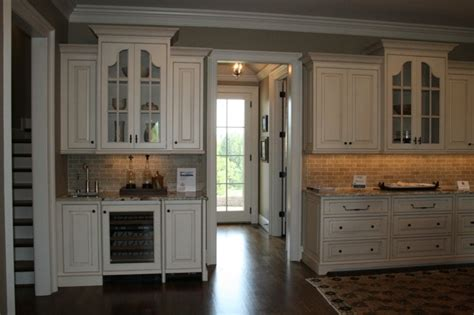 brick backsplash white cabinets dark floor home ideas