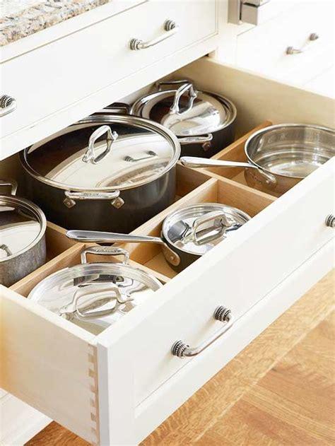 kitchen cabinets pots pans cabinet drawers storage organization drawer gardens better homes cupboards bhg