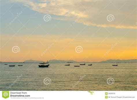 Small Fishing Boat Anchors by Small Fishing Boats Anchor Near Bay Royalty Free Stock