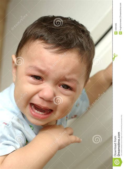 crying baby boy  royalty  stock photo image