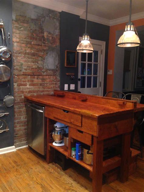 antique workbench  kitchen island  exposed brick