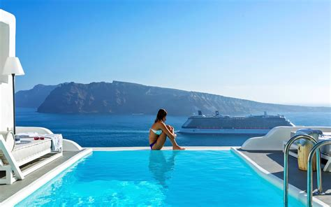 Woman Enjoying The Amazing Santorini Caldera View From The