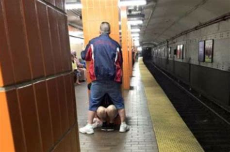 Irate Commuter Takes Photo Of Over Amorous Couple On