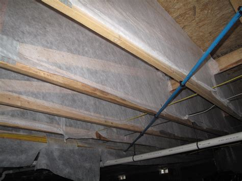 insulating floor above vented crawlspace with cellulose